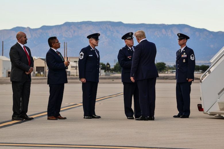 President Donald J. Trump greets the leadership of Team Kirtland at Kirtland Air Force Base, N.M., Sept. 16, 2019. After departing Joint Base Andrews, Md., the President landed at Kirtland and was greeted by members of the base. (U.S. Air Force photo by Staff Sgt. Kimberly Nagle)