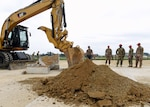 Airmen from the 51st Civil Engineer Squadron and the 554th Rapid Engineer Deployable Heavy Operational Repair Squadron assigned to Andersen Air Force Base, Guam, watch as an excavator rips up a section of concrete during the 51st CES' biannual rapid airfield damage repair training on Osan Air Base, Republic of Korea, September 12, 2019. This training is designed to demonstrate the squadron's ability to rapidly repair the airfield after its been damaged.