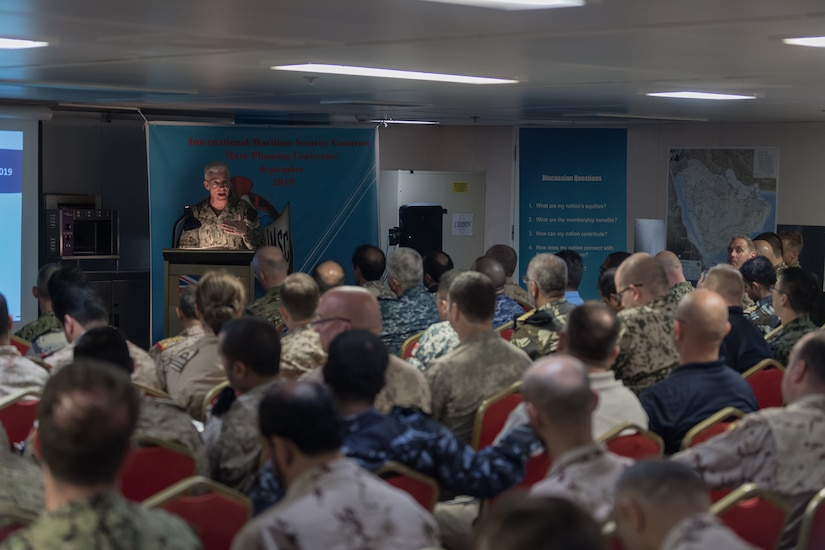 ARABIAN GULF - (Sept. 16, 2019) Vice Adm. Jim Malloy, commander, U.S. Naval Forces Central Command, U.S. 5th Fleet and Combined Maritime Forces, delivers remarks during the opening ceremony for International Maritime Security Construct (IMSC) Main Planning Conference aboard HMS Cardigan Bay (K630) Sept. 16. IMSC Task Force is headquartered in Bahrain. Current members include the United Kingdom, Australia, the Kingdom of Bahrain, and the United States.(U.S. Navy photo by Mass Communication Specialist 1st Class David Hooper/Released)