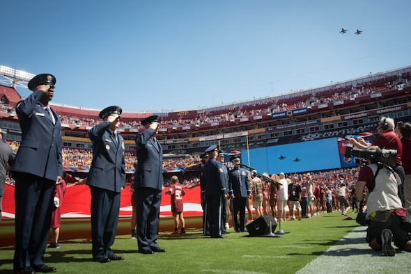 D.C. Air National Guard F-16s fly over FedEx Field in the opening ceremony of the NFL Washington Redskins vs. Dallas Cowboys game, September 15, 2019. The Washington Redskins recognized the Air Force throughout the game to honor the Air Forces 72nd birthday. (U.S. Air National Guard photo by Tech. Sgt. Erica Flores)