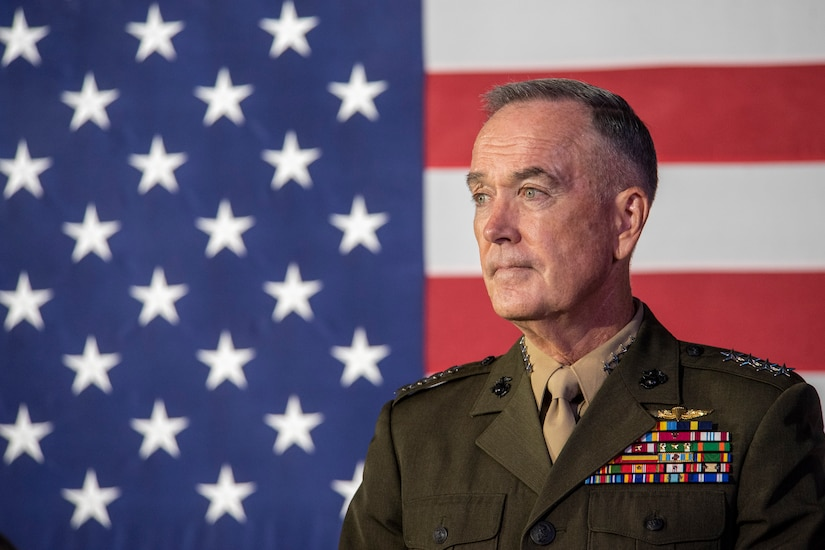 Marine Corps Gen. Joe Dunford, chairman of the Joint Chiefs of Staff,  stands in front of an American flag.