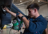 Marine Sgt. Salvatore F. Cuneo, an avionics technician with Marine Attack Training Squadron 203, adjusts wiring inside the fuselage of an T/AV-8B Harrier II prior to it being moved to outside storage at Marine Corps Air Station Cherry Point, North Carolina, Sep. 16, 2019. Marines attached to VMAT-203 execute daily maintenance to ensure dependability of the aircraft as well as the capability for it be ready at any moment's notice. VMAT-203 is a part of Marine Aircraft Group 14, 2nd Marine Aircraft Wing.  (U.S. Marine Corps photo by Lance Cpl. Elias E. Pimentel III)