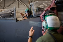 Marine Sgt. Salvatore F. Cuneo and Cpl. Angel J. Garcia, avionics technicians with Marine Attack Training Squadron 203, test communication equipment in the cockpit of an T/AV-8B Harrier II prior to it being moved to outside storage at Marine Corps Air Station Cherry Point, North Carolina, Sep. 16, 2019. Marines attached to VMAT-203 execute daily maintenance to ensure dependability of the aircraft as well as the capability for it be ready at any moment's notice. VMAT-203 is a part of Marine Aircraft Group 14, 2nd Marine Aircraft Wing.  (U.S. Marine Corps photo by Lance Cpl. Elias E. Pimentel III)
