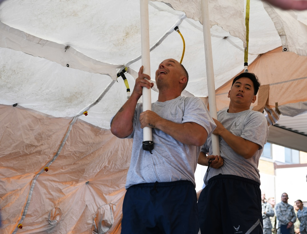 Airmen from the 28th Medical Group set up a decontamination tent during an exercise at Ellsworth Air Force Base, S.D., Sept. 13, 2019. Airmen who participated in the decontamination exercise were timed and graded on their ability to respond to a simulated Chemical, Biological, Radiological and Nuclear threat by donning their hazardous materials suits, setting up a DECON station, and cleaning a training dummy to ensure they were free of any contaminates. (U.S. Air Force photo by Senior Airman Thomas Karol)