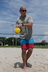 Marine Sgt. Maj. Rodney E. Nevinger, Marine Wing Headquarters Squadron 2 sergeant major, prepares to serve the ball during a volleyball game at a unit Family Fun Day at Marine Corps Air Station Cherry Point, North Carolina, August 20, 2019. The Family Fun Day was hosted to give Marines and Sailors an opportunity to socialize and build camaraderie throughout the unit.  (U.S. Marine Corps photo by Pfc. Steven Walls)