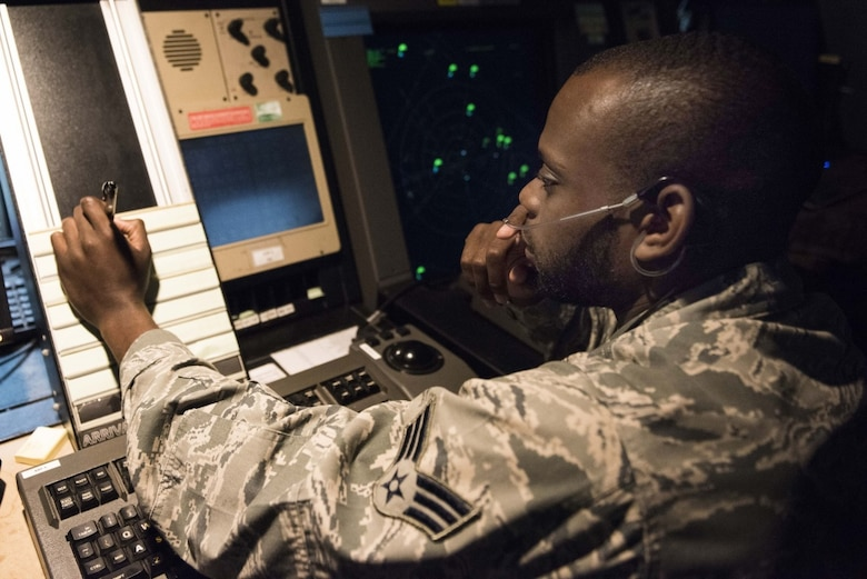 U.S. Air Force Senior Airman Tyler Glass, 39th Operations Support Squadron air traffic controller, communicates with an aircraft in a radar approach and control facility Aug. 9, 2019, at Incirlik Air Base, Turkey. Air traffic controllers are responsible for guiding air traffic and keeping aircraft at a safe distance from one another. (U.S. Air Force photo by Staff Sgt. Joshua Magbanua)