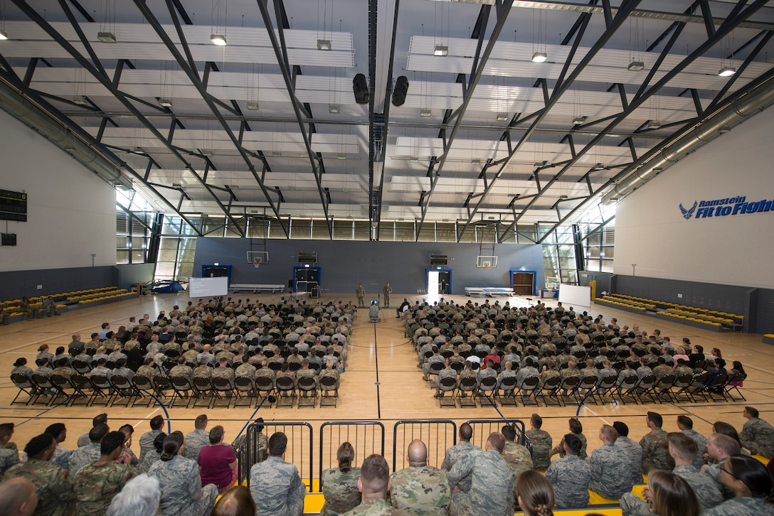 U.S. Air Force Brig. Gen. Mark R. August, 86th Airlift Wing commander, and Chief Master Sgt. Ernesto Rendon, 86th AW command chief, speak to Airmen at an all-call at Ramstein Air Base, Germany, Sept. 17, 2019. August and Rendon discussed accomplishments of the 86th AW in 2019, preparation for Operation Varsity 19-03 and 19-04, and the upcoming Unit Effectiveness Inspection.
