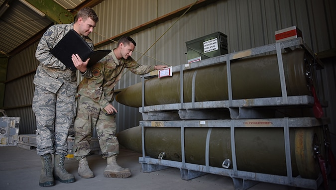 "U.S. Air Force Staff Sgt. Gavin Henderson, 39th Maintenance Squadron munitions operations technician, (left), and Staff Sgt. Bryan Gibree, 39th MXS munitions inspection supervisor, inspect bombs during an inventory Sept. 11, 2019, at Incirlik Air Base, Turkey. Munitions Airmen, commonly known as ""AMMO troops,"" are responsible for the storage, inspection, transportation and issuance of ammunition to various constituents for their respective missions. (U.S. Air Force photo by Staff Sgt. Joshua Magbanua)"