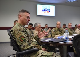 Maj. Gen. Rauch engages in a discussion.