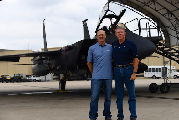 The 15h Chief Master Sgt. of the Air Force Rodney McKinley and Ray Iacomacci pose in front of a F-15E Strike Eagle at Seymour Johnson Air Force Base, North Carolina. (U.S. Air Force Photo by Staff Sgt. Michael Charles)