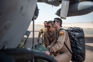 Members of the 336th Expeditionary Fighter Squadron walk up to a C-130 Hercules to forward deploy Sept. 17, 2019, at Al Dhafra Air Base, United Arab Emirates. The unit traveled to Price Sultan Air Base, Saudi Arabia to operate missions and challenge their flexibility at expanding tactical and strategic reach while strengthening coalition and regional partnerships in the Air Forces Central Command area of responsibility. (U.S. Air Force photo by Staff Sgt. Chris Thornbury)