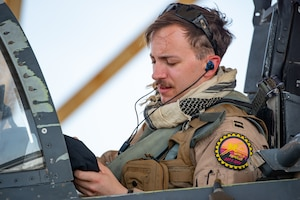 "Capt. ""Spear"" Del Ponte, 336th Expeditionary Fighter Squadron pilot, prepares for flight for Agile Strike Sept. 18, 2019, at Al Dhafra Air Base, United Arab Emirates. The 336th EFS sent two aircraft and personnel to operate missions out of Prince Sultan Air Base, Saudi Arabia to challenge their flexibility at expanding tactical and strategic reach while strengthening coalition and regional partnerships in the Air Forces Central Command area of responsibility through adaptive basing. (U.S. Air Force photo by Staff Sgt. Chris Thornbury)"