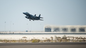 An F-15E Strike Eagle, assigned to the 336th Expeditionary Fighter Squadron, takes off for Agile Strike Sept. 18, 2019, at Al Dhafra Air Base, United Arab Emirates. The 336th EFS sent two aircraft and personnel to operate missions out of Prince Sultan Air Base, Saudi Arabia to challenge their flexibility at expanding tactical and strategic reach while strengthening coalition and regional partnerships in the Air Forces Central Command area of responsibility through adaptive basing. (U.S. Air Force photo by Staff Sgt. Chris Thornbury)