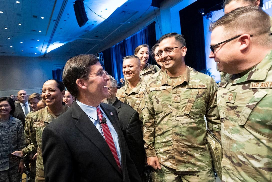 Defense Secretary Dr. Mark T. Esper speaks to airman.