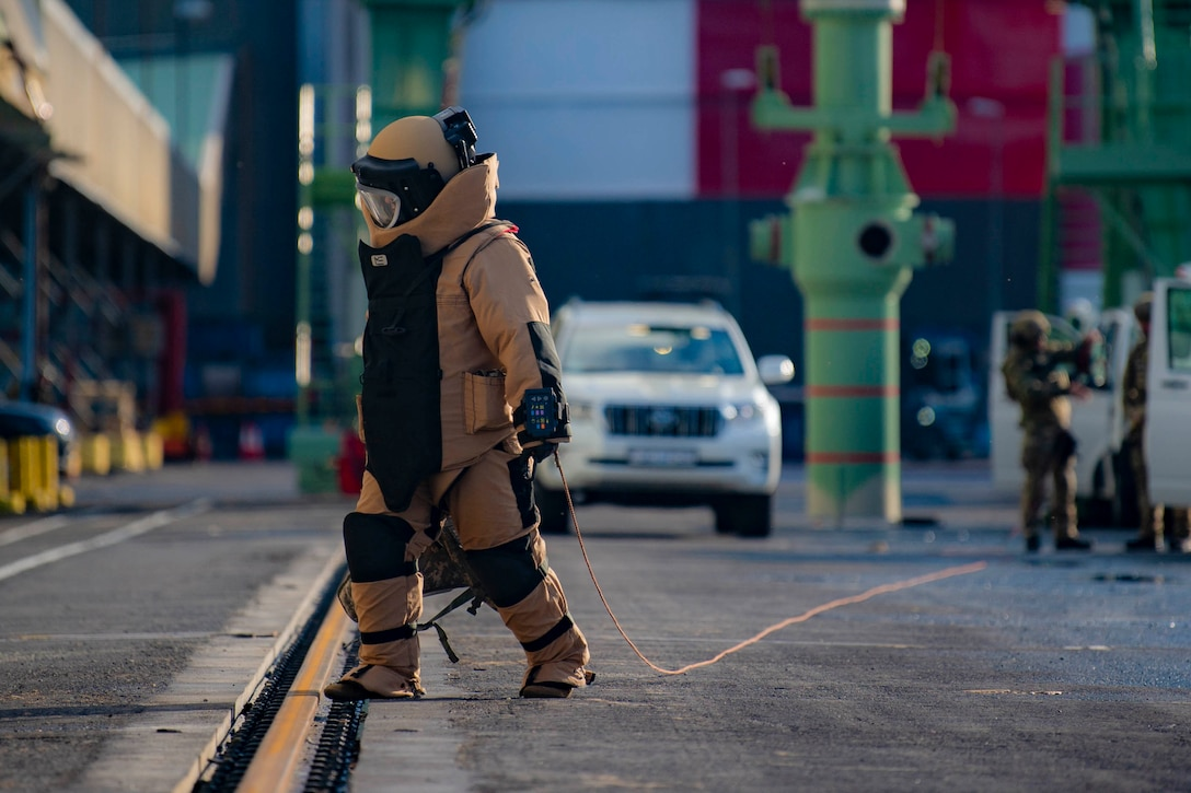 A sailor wearing an bomb suit.
