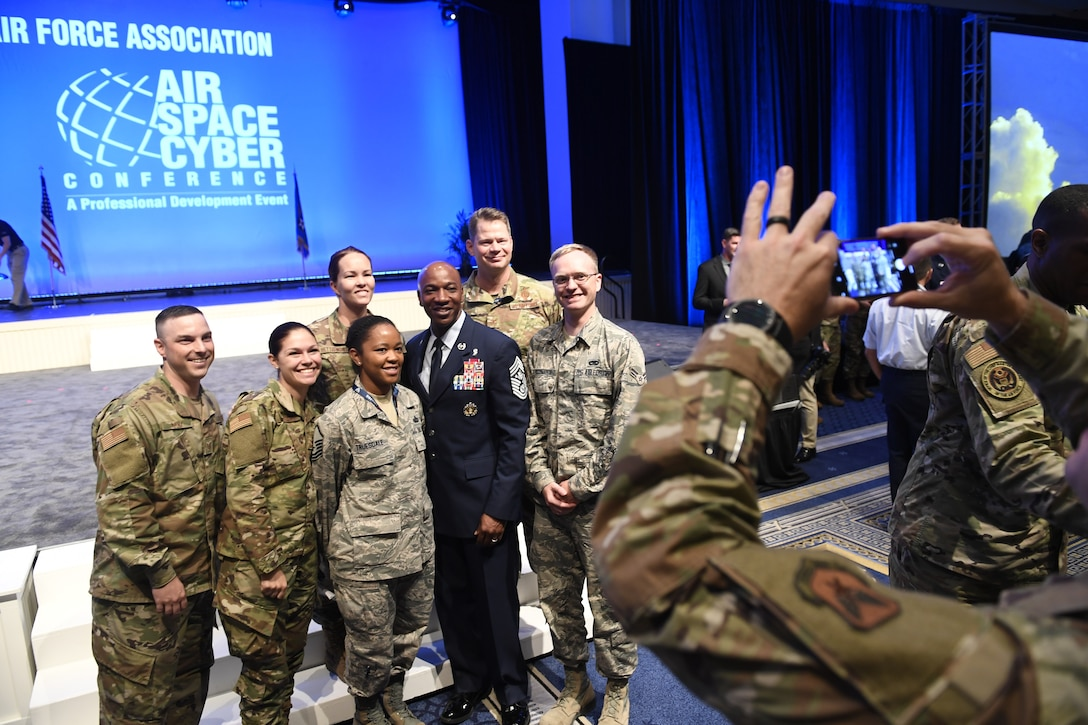 Chief Master Sgt. of the Air Force Kaleth O. Wright poses for selfies with Airmen after delivering a speech on leading with purpose during the Air Force Association's Air, Space and Cyber Conference in National Harbor, Md., Sept. 18, 2019. The ASC Conference is a professional development seminar that offers the opportunity for Department of Defense personnel to participate in forums, speeches and workshops. This annual event features engaging speakers and panels focused on airpower, space and cyber developments and a technology exposition featuring the latest technology, equipment and solutions for tomorrow's problems. The ASC has something for everyone. (U.S. Air Force photo by Andy Morataya)