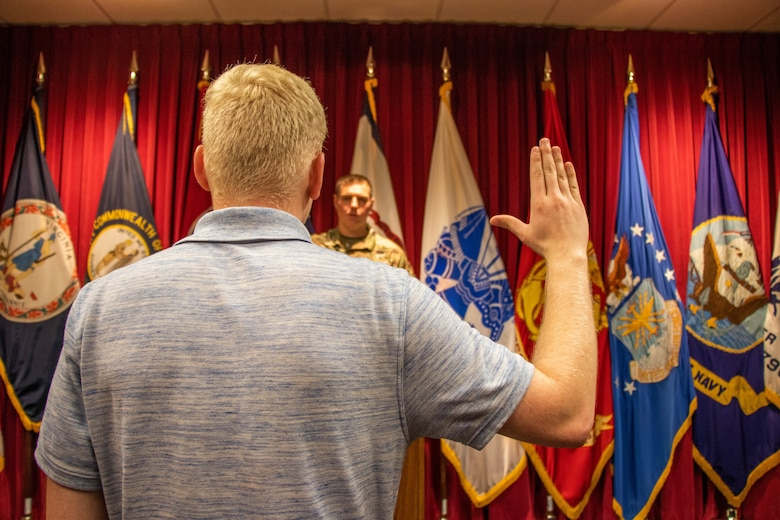 Pvt. 1st Class Michael Winter recites the Oath of Enlistment at the MEPS, in Beckley, West Virginia.