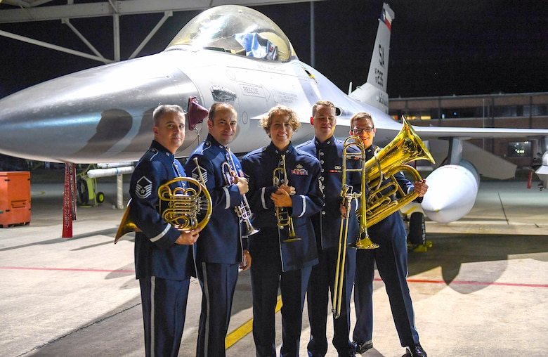 Members of the United States Air Force Band of the West pose in front of an F-16 Fighting Falcon, an aircraft assigned to the 149th Fighter Wing Sept. 18 at Joint Base San Antonio-Lackland in honor of the Air Force's 72nd birthday.