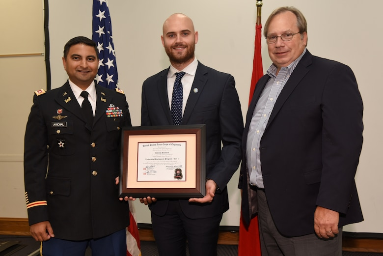 Andrew Stanford, U.S. Army Corps of Engineers Nashville District, receives a certificate of completion for the 2019 Leadership Development Program Level I Course from Lt. Col. Sonny B. Avichal, Nashville District commander, and Michael Evans, course instructor, during a graduation ceremony Sept. 12, 2019 at the Scarritt Bennett Center in Nashville, Tenn. (USACE Photo by Lee Roberts)