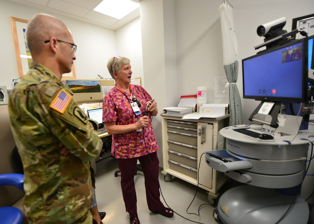 Lt. Gen. Ronald J. Place, the new Director of the Defense Health Agency, learns about the Stuttgart Army Health Clinic's Virtual Health Capabilities during his visit to Stuttgart on Sept. 11. Place was the Keynote Speaker at the TRICARE Eurasia Africa Commanders and Stakeholders Meeting at Sembach Kaserne, Germany, Sept 9-13. During the visit, he also met with senior military leaders and Surgeons General from Unified Combatant Commands. (Courtesy photo)