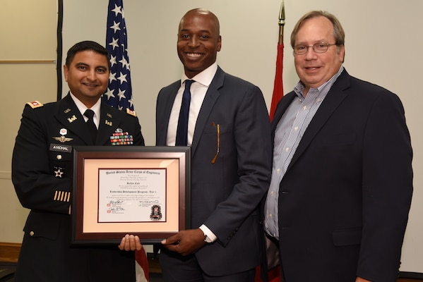 Kellen Cole, U.S. Army Corps of Engineers Nashville District, receives a certificate of completion for the 2019 Leadership Development Program Level I Course from Lt. Col. Sonny B. Avichal, Nashville District commander, and Michael Evans, course instructor, during a graduation ceremony Sept. 12, 2019 at the Scarritt Bennett Center in Nashville, Tenn. (USACE Photo by Lee Roberts)