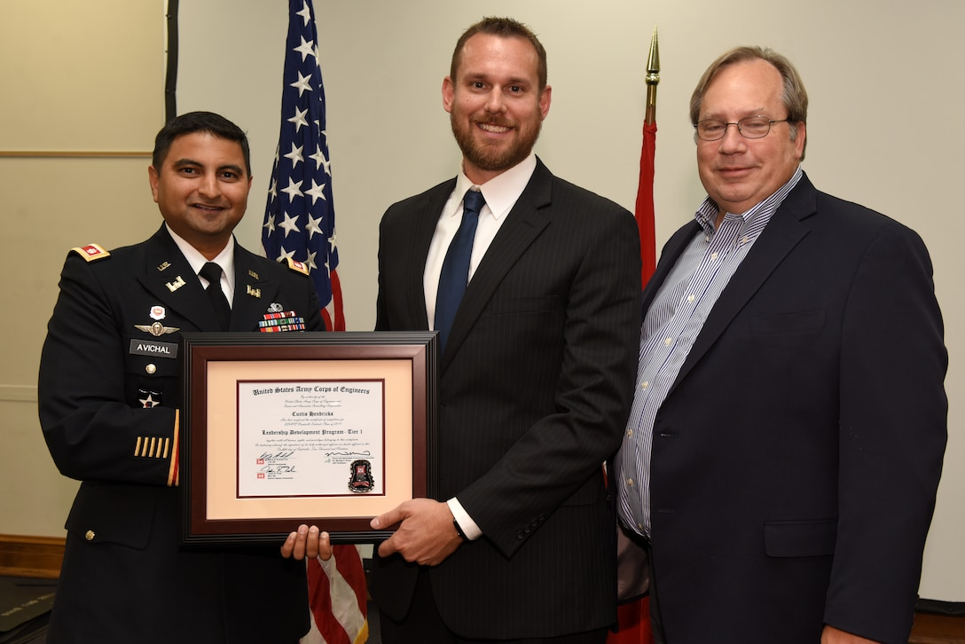 Curtis Hendricks, U.S. Army Corps of Engineers Nashville District, receives a certificate of completion for the 2019 Leadership Development Program Level I Course from Lt. Col. Sonny B. Avichal, Nashville District commander, and Michael Evans, course instructor, during a graduation ceremony Sept. 12, 2019 at the Scarritt Bennett Center in Nashville, Tenn. (USACE Photo by Lee Roberts)