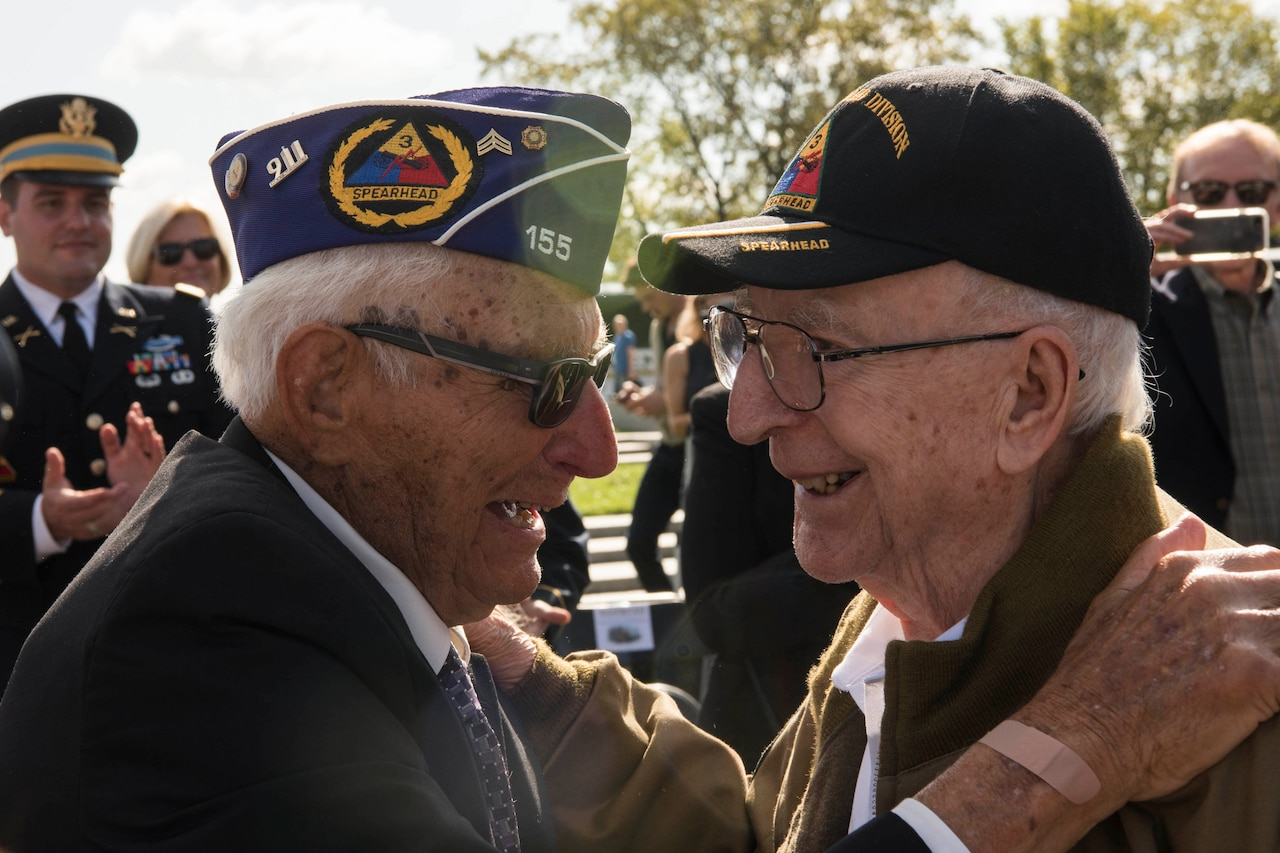 Two veterans embrace.