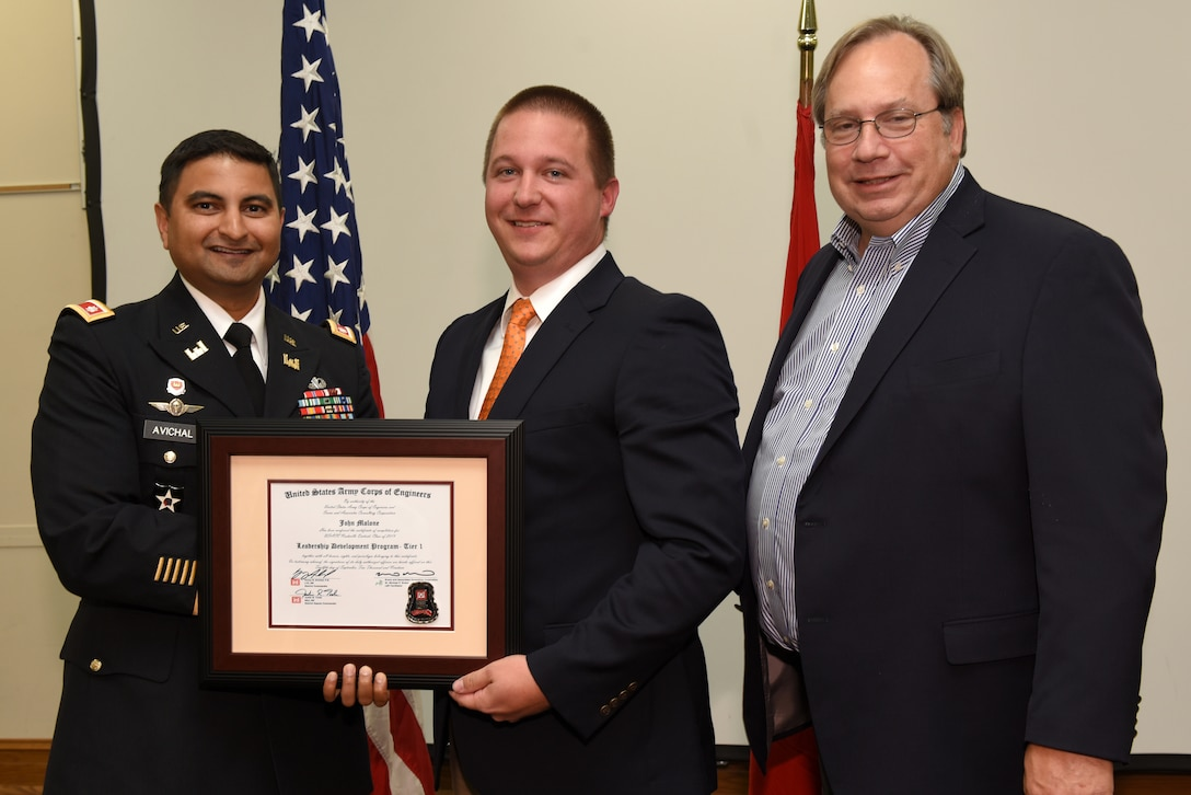 John Malone, U.S. Army Corps of Engineers Nashville District, receives a certificate of completion for the 2019 Leadership Development Program Level I Course from Lt. Col. Sonny B. Avichal, Nashville District commander, and Michael Evans, course instructor, during a graduation ceremony Sept. 12, 2019 at the Scarritt Bennett Center in Nashville, Tenn. (USACE Photo by Lee Roberts)