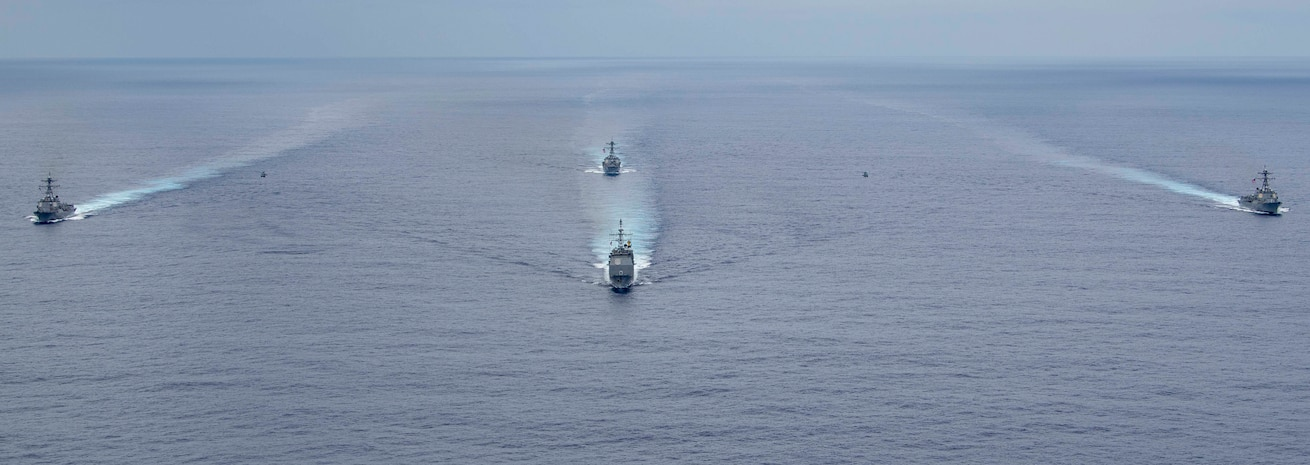 The Ticonderoga-class guided-missile cruiser USS Normandy (CG 60), front, and the Arleigh Burke-class guided-missile destroyers, USS Farragut (DDG 99), left, USS Forrest Sherman (DDG 98), right, and USS Lassen (DDG 82), back, steam in formation during a Photo Exercise Sept. 16, 2019.
