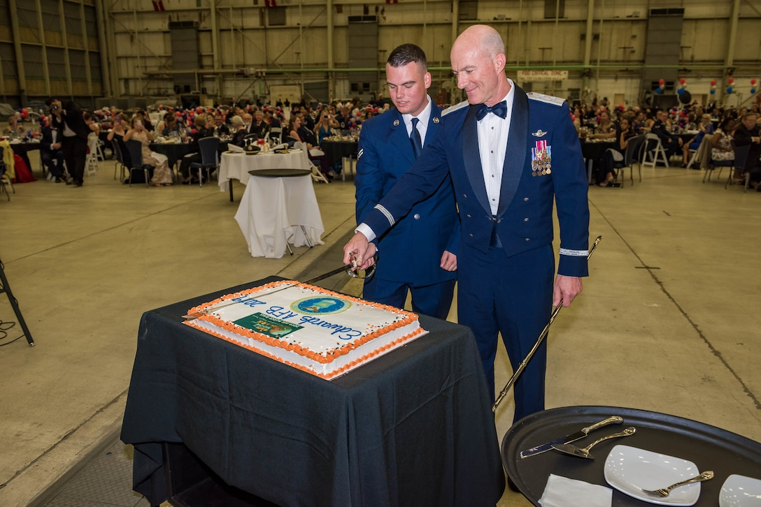 Air Force Test Center Commander, Maj. Gen. Christopher Azzano, and Airman 1st Class Liam Paul, the most-junior Airman in attendance, cut the Air Force Birthday cake during the 2019 Air Force Ball at Edwards Air Force Base, California, Sept. 14. (U.S. Air Force photo by Matt Williams)