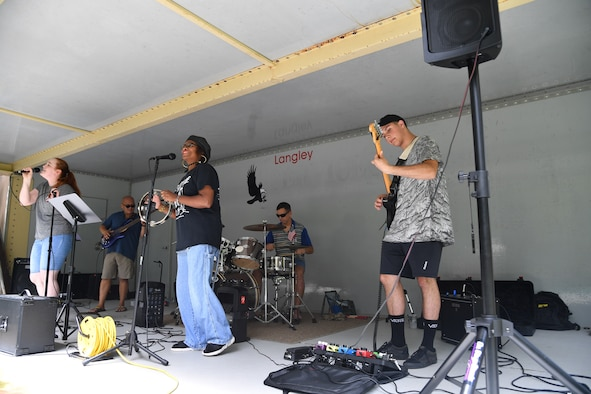 Collateral Damage entertains Airmen and their families during the 363d ISR Wing's annual summer picnic at Bethal Park, Virginia, July 23, 2019. The band has been around since before the wing's activation. (U.S. Air Force photo by Robert Mehal)