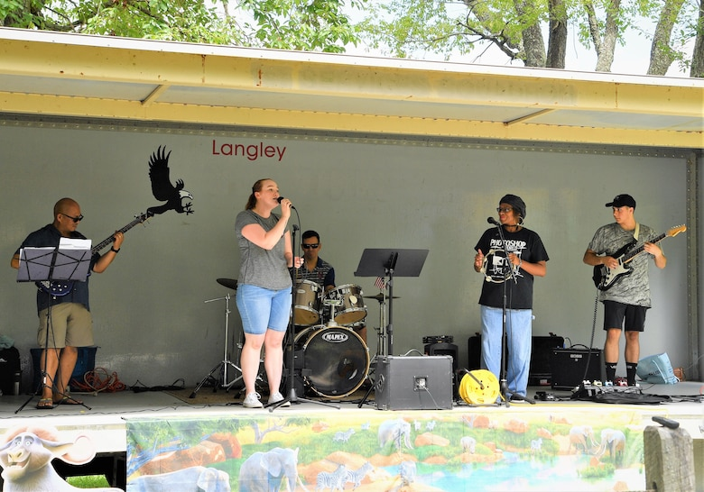 Members of the 363d ISR Wing's band, Collateral Damage, perform at the command's annual summer picnic at Bethal Park, Virginia, July 23, 2019. The band has been around since before the wing's activation. (U.S. Air Force photo by Robert Mehal)