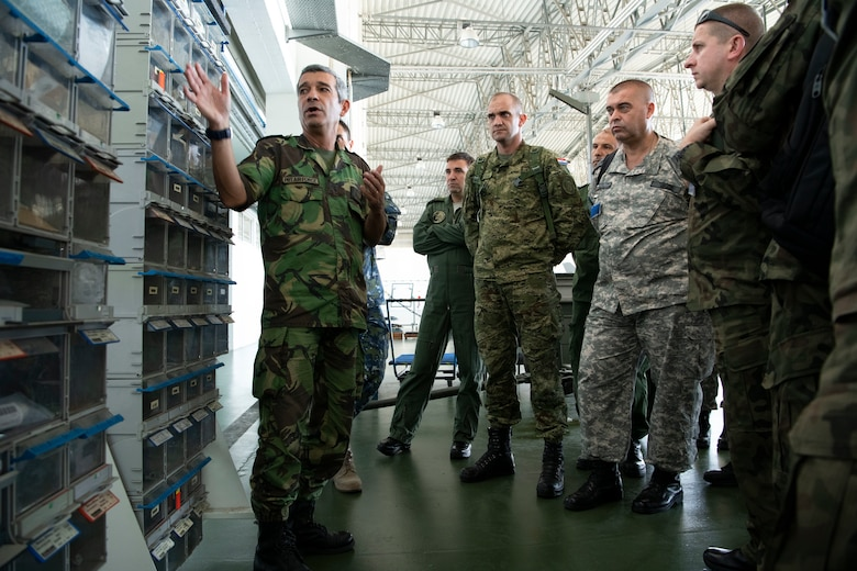 Portuguese air force Lt. Col. Paulo Carvalho, demonstrates the use of kanbans as part of the Portuguese air force's lean management system, during the European Partnership Flight at Monte Real Air Base, Portugal, Sept. 10, 2019. The European Partnership Flight serves as an opportunity for the U.S. and partner nations to share best practices, strengthen relationships, and build trust. (U.S. Army photo by Spc. Catessa Palone)