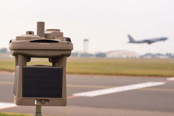 A micro weather sensor sits on the flight line Sept. 10, 2019, at RAF Mildenhall, England. The device is able to provide Airmen information on cloud height, cloud coverage, wind speed and direction, precipitation, lighting detection and atmospheric pressure. (U.S. Air Force photo by Airman 1st Class)