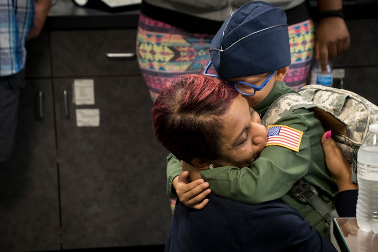 "Ayden Houston hugs his mother after being named an honorary ""Pilot for a Day"" as part of a special event, Sept. 15, 2019, at the 179th Airlift Wing, Mansfield, Ohio. The 164th Airlift Squadron, assigned to the 179 AW, collaborated with ""A Special Wish Foundation"" of Cleveland, Ohio, to provide Ayden with this unique experience he could share with his family who have been battling a variety of health issues with Ayden since birth.  (U.S. Air National Guard photo by Tech. Sgt. Joe Harwood)"