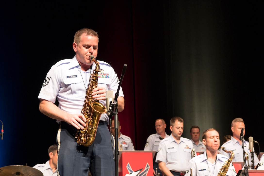 Tech. Sgt. Ryan Leatherman, U.S. Air Force Band of Mid-America Shades of Blue Jazz Ensemble saxophonist, performs a solo during a concert at the Honeywell Center in Wabash, Indiana Sept. 10, 2019. Prior to joining the Air Force his career took him throughout the United States and Europe, where he performed with renowned artists in a variety of musical styles, including Dick Oatts, Bobby Shew, Sinfonia da Camera, and The Temptations. (U.S. Air Force photo/Master Sgt. Ben Mota)