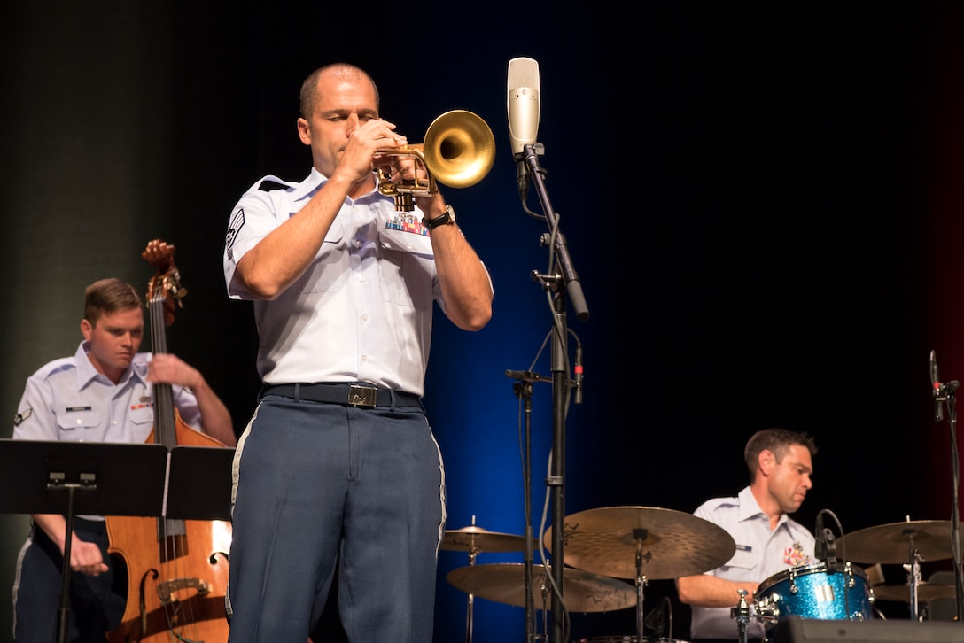 Staff Sgt. Benjamin Paille, U.S. Air Force Band of Mid-America Shades of Blue Jazz Ensemble trumpet player, performs a solo during a concert at the Honeywell Center in Wabash, Indiana Sept. 10, 2019. Paille was a featured soloist in the Broadway show BLAST!, and has performed with Christian Mcbride, Robert Glasper, Cyrus Chestnut, Kevin Mohogany, Warren Wolf, Jason Moran, Eric Reed, and many others. (U.S. Air Force photo/Master Sgt. Ben Mota)