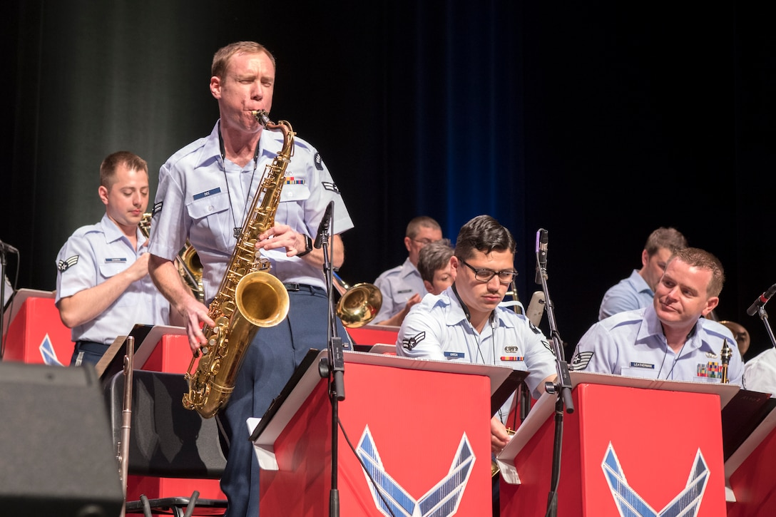 Airman 1st Class Michael Dee, U.S. Air Force Band of Mid-America Shades of Blue Jazz Ensemble saxophonist, performs a solo during a concert at the Honeywell Center in Wabash, Indiana Sept. 10, 2019. Prior to joining the Air Force, Airman Dee toured extensively across the United States and abroad with the funk and soul band Josh Hoyer and Soul Colossal. (U.S. Air Force photo/Master Sgt. Ben Mota)