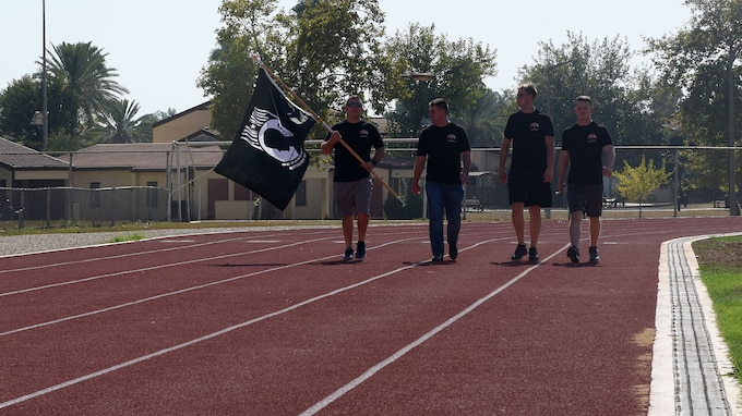 Members of the 728th Air Mobility Squadron carry the Prisoner of War/Missing in Action flag Sept. 19, 2019, at Incirlik Air Base, Turkey. These Airmen were the first to carry the flag during the event to honor POW/MIA service members. (U.S. Air Force photo by Staff Sgt. Trevor Rhynes)