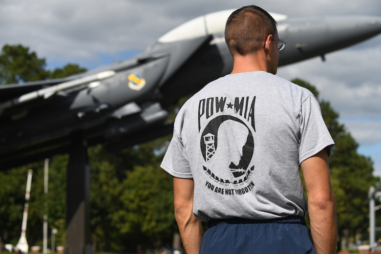 MSgt Elijah Docker, 4th Component Maintenance Squadron assistant first sergeant, looks on during the POW/MIA Ceremony on Sept. 18, 2019, at Seymour Johnson Air Force Base, North Carolina. Docker was chosen as the first runner of the flag during the kick-off of the National POW/MIA Remembrance Day 24 hour marathon. (U.S. Air Force photo by Staff Sgt Michael Charles)