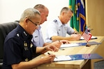 From left to right: Air Marshal Tarin Punsri, Royal Thai Air Force; Maj. Gen. Brian Killough, U.S. Air Force-Pacific Deputy Commander; and Brig. Gen. Jeremy Horn, assistant adjutant general, Washington Air National Guard, sign an agreement between units after the sixth Airmen-to-Airmen talks Aug. 28, 2019, at Camp Murray, Wash. The Airmen-to- Airmen talks are intended to continue the strengthening of relationships between the Washington National Guard and the Royal Thai Air Force. The meet was part of the National Guard State Partnership Program. Washington and the Kingdom of Thailand have been partners since 2002.