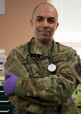 Tech Sgt. Simon Oliver, 459th Aeromedical Staging Squadron medical technician, poses for a photo Sept. 19, 2019, at Joint Base Andrews, Md. Oliver recently played a part in saving a passengers life while on a commercial flight to Jamaica. He credits his skills to his Air Force training. (U.S. Air Force photo by Staff Sgt. Cierra Presentado/Released)