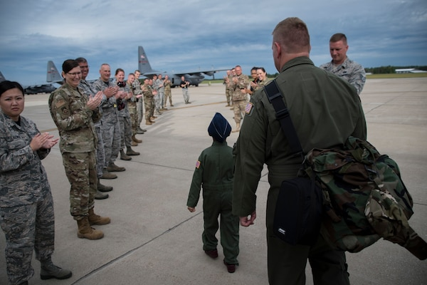 "Ayden Houston, 6, walks with aircrew to the flight line after being named honorary ""Pilot for a Day"" Sept. 15, 2019, at the 179th Airlift Wing, Mansfield, Ohio. The 164th Airlift Squadron collaborated with A Special Wish Foundation of Cleveland to provide Ayden with the unique experience. He has been battling a variety of health issues since birth."