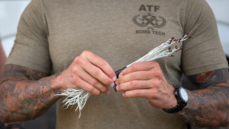 Christopher Nicolussi, a Bureau of Alcohol, Tobacco, Firearms and Explosives certified explosive specialist, removes the tape from squib detonators, which will be used to ignite the explosives during a joint disposal procedure at the Avon Park Air Force Range, Fla., Sept. 9, 2019. The ATF seized over 7,000 pounds of explosives from a prior convicted felon in the largest explosives seizure in Florida history.