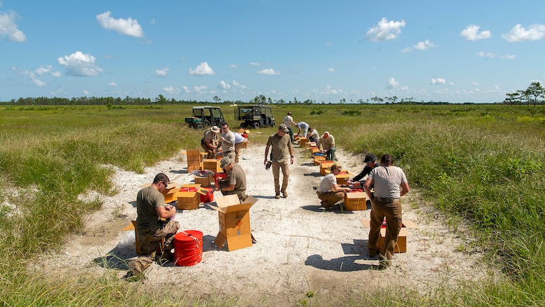 Members of the 6th Civil Engineer Explosive Ordnance Disposal Flight, the Bureau of Alcohol, Tobacco, Firearms and Explosives, and other local and state authorities, prepare to detonate evidence left over from a federal case during a joint training disposal procedure at the Avon Park Air Force Range, Fla., Sept. 9, 2019. The agencies disposed of the more than 7,000 pounds of explosives through controlled detonations.