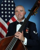 Official photo of A1C Brian Ellingsen, Bassist with The United States Air Force Band of the West, Joint Base San Antonio.
