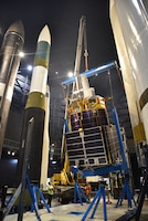 Photo of construction equipment and a test satellite.