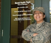 U.S. Air Force Senior Airman Mayra Serrano, a mental health technician assigned to the 628th Medical Group, stands in front of the Mental Health Clinic entrance Sept. 16, 2019, at Joint Base Charleston, S.C. Air Force medical technicians like Serrano help ensure the medical readiness, both physically and mentally, of over 200,000 Airmen around the world.
