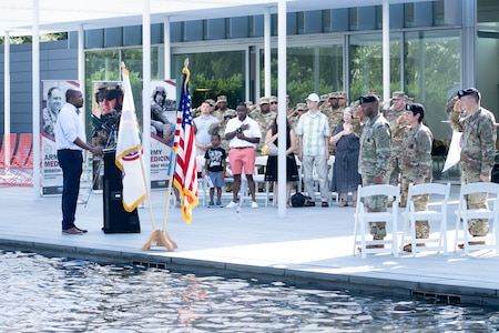 Soldiers and family members assigned to the Houston Medical Recruiting Company render honor during the singing of the National Anthem by Otis Toussaint, 5th Medical Recruiting Battalion, at the unit's change of command ceremony at Hermann Park Conservancy, Houston, Texas, Sept. 5.