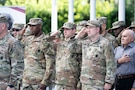 Soldiers and family members assigned to the Houston Medical Recruiting Company render honor during the National Anthem at the unit's change of command ceremony at Hermann Park Conservancy, Houston, Texas, Sept. 5.